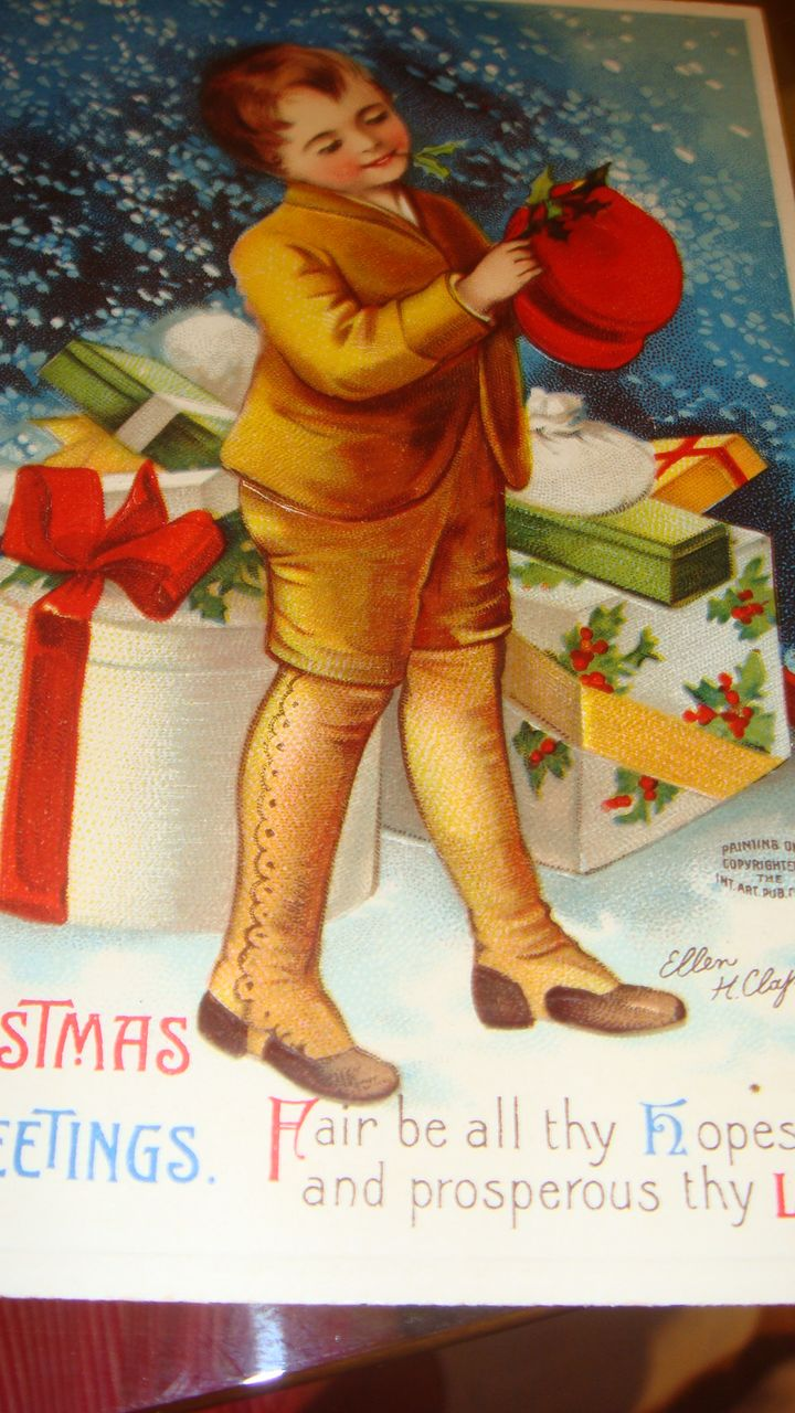 Signed Ellen Clapsaddle Christmas Embossed Postcard Berlin, Young Boy with Hat Boxes and Gift Boxes Red Hat