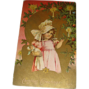 SALE Embossed Victorian Era Christmas Postcard Little Bonnet Girl With Her Doll Gold Gilt