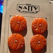 Six Carved Orange Bakelite Buttons