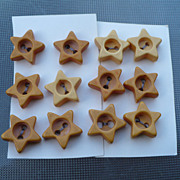 12 Bakelite Star Buttons