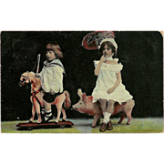 Real Photo Postcard of Two Children on Toy Horse and Pig - 1908 - 2 of 2