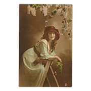 Raphael Tuck Hand Colored Photo Postcard of Lady on Ladder