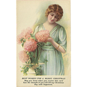 SOLD Christmas Postcard of Beautiful Blonde with Flowers - Artist Signed