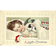 Embossed 1914 Christmas Postcard of Child Asleep with Toys