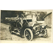 Real Photo Postcard of Man Driving Old Car