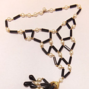 SALE 1960's Bib statement necklace with tassel and plastic black and pearl white beads