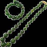 Vintage 1950s green Bakelite necklace and matching wrap bracelet