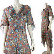 1970's Vintage Gauzy Cotton Dress With Handkerchief Point Sleeves And Hemline