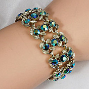 Dark Aurora Borealis rhinestone bracelet with light gold tone base