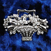 Gorgeous crystal rhinestone flower basket brooch in Silver tone