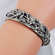 Bracelet beautiful side clasp 11/16 inch wide silver tone high relief