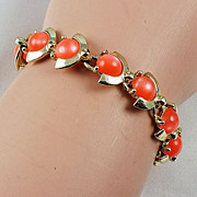 Vintage gold tone bracelet with Tangerine Lucite round cabochons