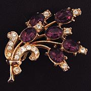 Vintage floral spray brooch with deep purple and colorless rhinestones