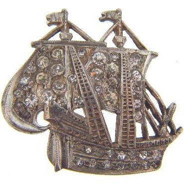 Figural sailing ship brooch with crystal rhinestone.