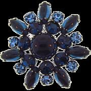 Vintage shades of blue rhinestone Brooch set in gun metal finish frame.