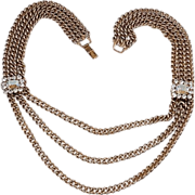 Heavy 3 chain gold tone necklace in three sections with rhinestones