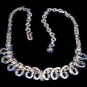 Adjustable gold tone necklace crystal rhinestone chain & metal swirls