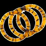 Trio of lucite tiger striped Bangle Bracelets