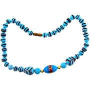 Unusual choker length art glass turquoise colored bead Necklace