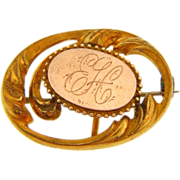 P.S.Co. gold filled watch pin with initials EH