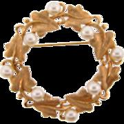 Signed Trifari circular vine design Brooch with imitation pearls