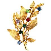Gorgeous sterling vermeil Brooch in a floral spray design with rhinestones
