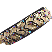 Signed Pegusus Coro wide Bracelet with AB red rhinestones