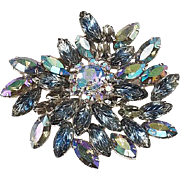 Larger blue Aurora Borealis rhinestone brooch Rhodium finish molded leaves