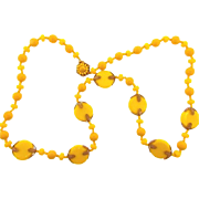 Signed Miriam Haskell bright yellow 28 inch long  bead Necklace with gold tone filigree findin