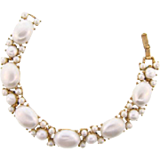 Signed Crown Trifari gold tone Bracelet with opalescent beads and imitation pearls