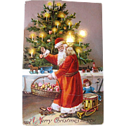 SOLD EAS German Gel Coated Christmas Postcard—Santa Claus Decorates Home