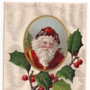 'A Merry Christmas' Santa Head in Cameo on a Holly Bough Postcard 1909
