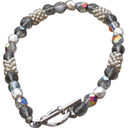 Silver Colored Seed Bead Bracelet with Grey Aurora Beads | 7.75 inches