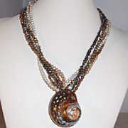 Sarmaticus shell pendant on 5 strand Freshwater Pearl Necklace