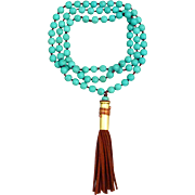 Turquoise Howlite Hand Knotted Necklace With Bullet Shell Casing And Suede Tassel