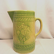 Antique Green Stoneware Pitcher with Fruit