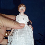"5.5"" Bisque head dollhouse doll dressed as a maid"