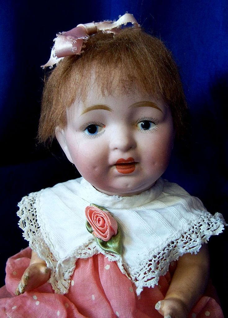 "9.5"" Bisque Head Baby Unmarked with painted Eyes"
