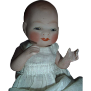 "SALE 6"" Bisque Bye-lo with Tummy Sticker, Sleep Eyes, Jointed Neck"