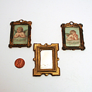 An 1890 Trio of Dolls House Pictures and Wall Mirror Angels or Cherubs