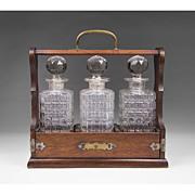 SALE English Edwardian Oak Tantalus With Three Glass Bottles