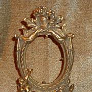 French Rococo Gilt Brass Frame With Cherub Decoration