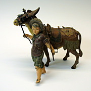 Great early large cold painted figure of a boy with a seaside Donkey