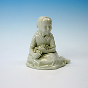 Early Royal Copenhagen figure of a girl with flowers