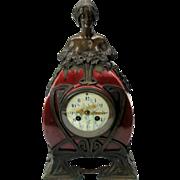 Art Nouveau bronze and Art Pottery mantle clock