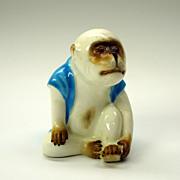 Rare glass eyed MOORE porcelain dressed MONKEY figure