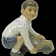 Dahl Jensen porcelain figure of a Boy with a toy car