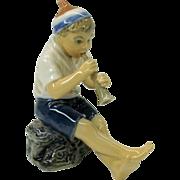 Dahl Jensen porcelain figure of pipe playing Boy