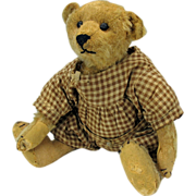 "Well loved early 12"" Steiff Teddy bear in gingham romper suit"