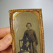 Fabulous antique tintype of a boy with a large dog